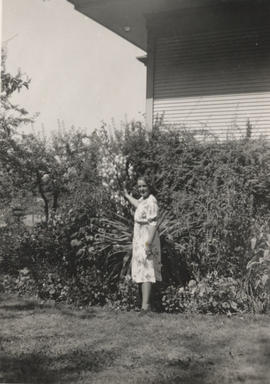 Maude Mair (nee Walker) with Yucca plant in the garden, Carey Road, 1941