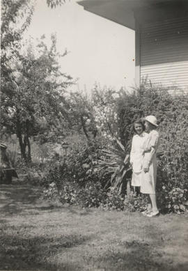 Mrs Brown and June (nee Todd) Norrington with Yucca plant in the garden, Carey Road, 1941