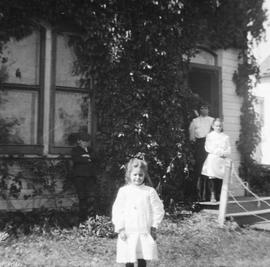 Dorothy Estlin, front, Mary Estlin on step, and Emily Maude Estlin behind in Melita, Manitoba