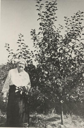 Mrs Ruby Sr. with apple tree