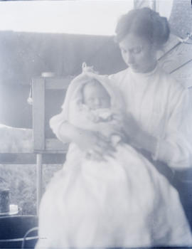 Laurie Clark holding infant Alex Gray