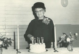 Mrs. Gertrude Miller (nee Grant) cutting cake at Gordon Head Mutual Improvement Society 70th anni...