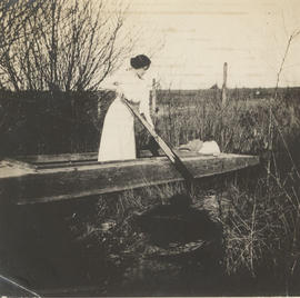 Anna Henderson in boat on Colquitz Creek