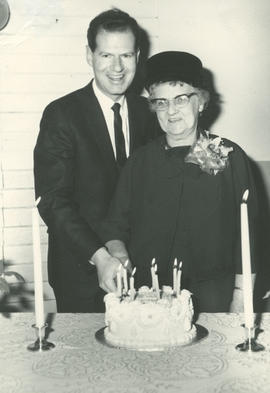 Reeve Hugh Curtis and Mrs. Gertrude Miller (nee Grant) cutting cake at Gordon Head Mutual Improve...