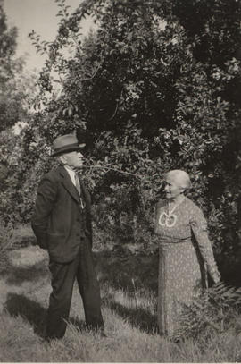 Anton and Ellen Henderson in the orchard at 3984 Carey Road