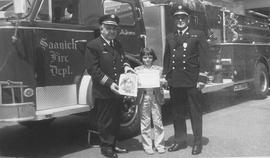 Saanich Fire Department presenting award to a child