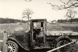 Leonard Orrico as a child in June Rosson's car made into truck