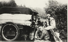 Changing a tire on the Malahat, 1927