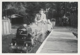 86 year old E.H. Livesay driving S.T. Sunter's locomotive at Mattick's Farm at Cordova Bay, 1968
