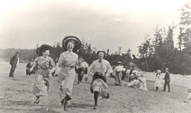 Young women racing on Cordova Bay Beach near McMorran's, 1912