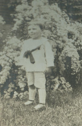 Child in front of flowering bush
