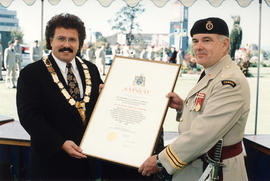 Mayor Murray Coell presenting the 11 (Victoria) Medical Company with the Freedom of Saanich, 1994