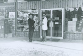 Arthur Logie with Fire Prevention poster at Carrigan's Lake Hill Drugs