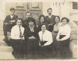 Staff members sitting on the steps of Tolmie School, 1914