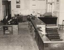 Municipal Clerk and Treasurer John Tribe working at the Saanich Municipal Hall during strike of 1953