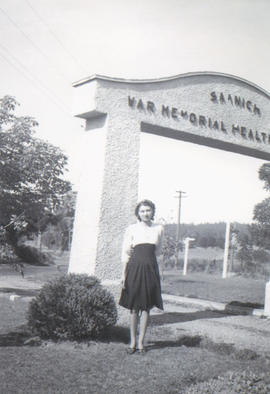 Arch of Saanich War Memorial Health Centre, Bella Moroz Kisiow in front, ca. 1941