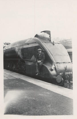 E.H. Livesay riding on locomotives in England