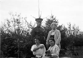 Mik Roberts and Emily Estlin with May Aitkens and Emily Maude Estlin (seated) on the Aitkens farm...