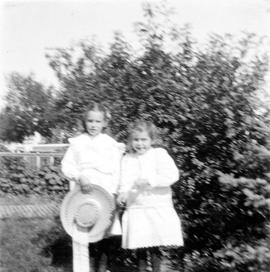 Alfred Estlin's children Mary and Dorothy in their garden in Melita, Manitoba