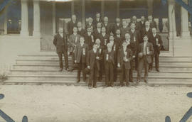 "Group of men in front of ""Dr. Kerr"" building"