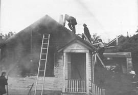 Saanich Fire Department fighting a house fire, 1972