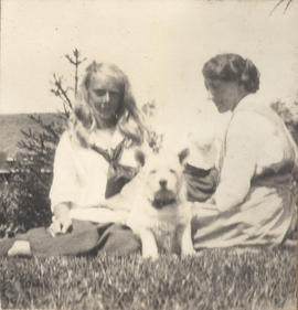 Barbara Hope on left sitting with dog and unidentified woman