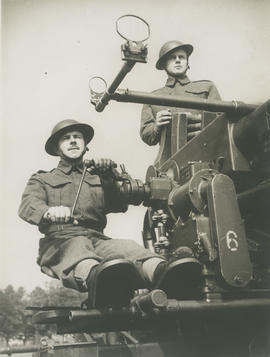 Ernie Underwood and Watson with anti-aircraft gun