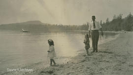 Children and man on the beach at Cordova Bay Camp
