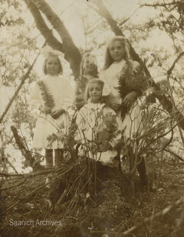 Girls holding ferns at Cordova Bay
