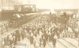 Crowds visiting the London Midland & Scottish Railway train, The Royal Scot, on display at th...
