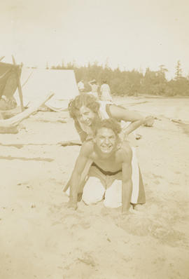 Emily Agnes Burke (later Underwood) and unidentified man on beach