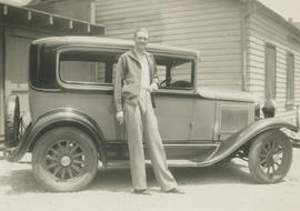Ben Hartsell beside car