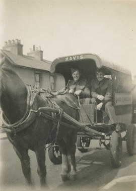 Ernie and Leslie Underwood in horse-drawn Hovis bakers delivery wagon, Potters Bar 1942