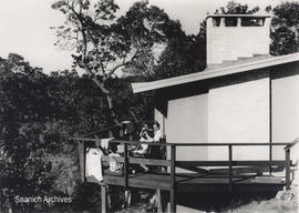 A group of people on the deck of Herbert and Heather Shield's house in Brentwood Bay