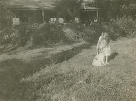 [Elizabeth Tatlow's granddaughter?] and dog in front of house