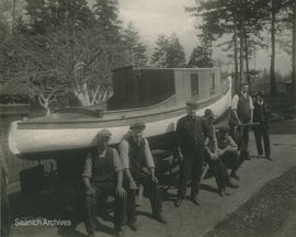 Returned soldiers with boat they built