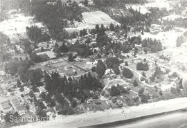 Aerial view of Cordova Bay showing Cordova Bay Community Hall, St. David's Church and Mattick's Farm