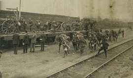 British soldiers with horses at train station