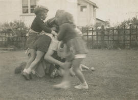 Kenny Messerschmidt, Fred Wright, Sharon Smith, and Leslie Underwood play fighting with Leslie H....