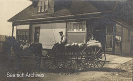 Reginald Chave with the delivery wagon for Wm. J. Chave & Son Grocers, in front of the grocer...