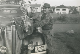 Murray MacDonald and child with hunting trophy