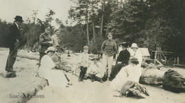 Group on beach including WWI soldiers