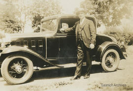 C.F. Dawson beside car, June 1932