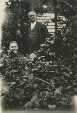 Ernie Underwood and uncle in back yard at Potters Bar