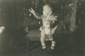 Leslie G. Underwood, age 16 months, in front of Christmas tree
