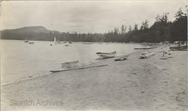 Cordova Bay Beach, First Nations canoes in distance