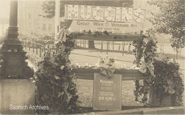 Postcard of Muggins, the Red Cross dog, on a stand built for him by the Great War Veterans' ...