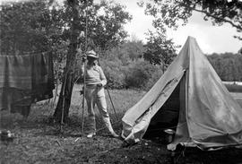 Frank Aitkens with fishing pole, camping with the Estlin family