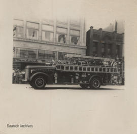 Saanich Fire Department truck in parade in downtown Victoria