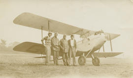 Men standing in front of DeHavilland DH.60 Moth G-CAKA airplane, Francis Charles Aitkens at right